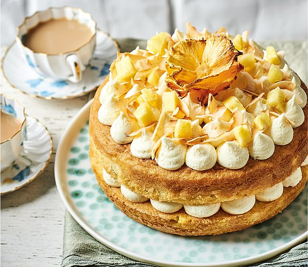 Place the pineapple flower in the centre of the cake and decorate with toasted coconut flakes and the reserved 50g of pineapple, chopped into 1cm pieces