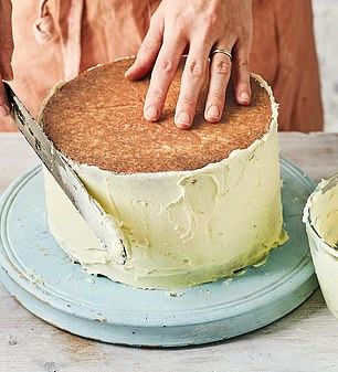 Once you have covered the side in a single coating of buttercream, spread an even layer over the top of the cake