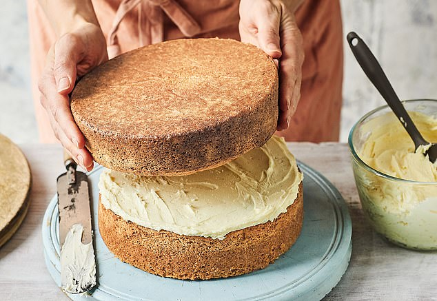 Generously spread some additional buttercream around the sides of the cake with a palette knife