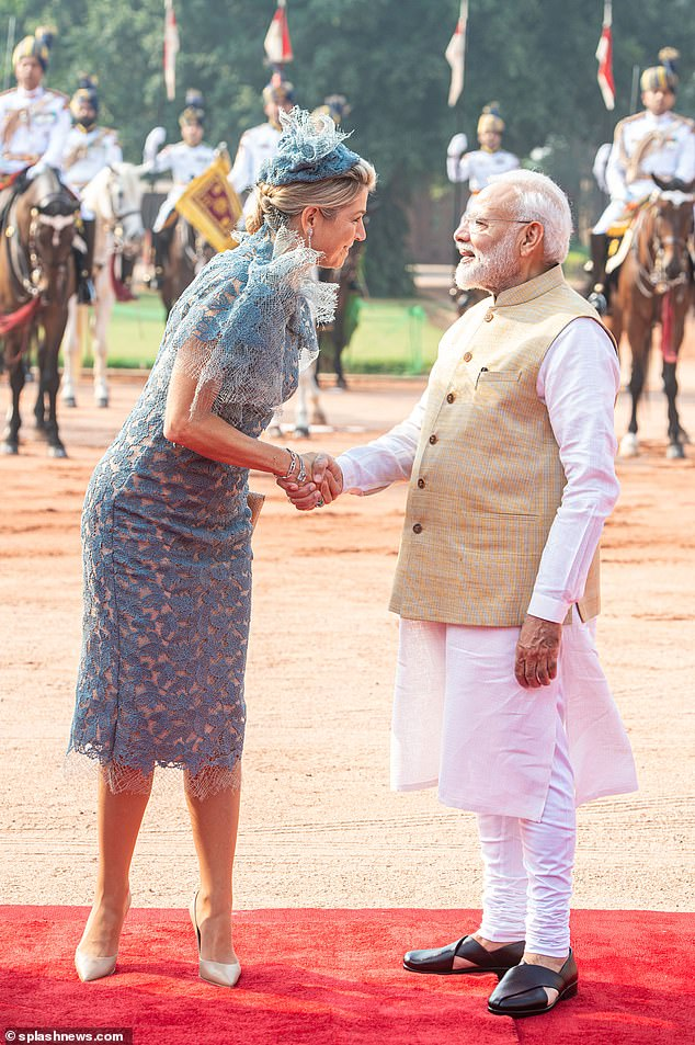 The royal appeared in high spirits as she met with the Indian Prime Minister Narendra Modi (right) on the first official day of her state visit in India