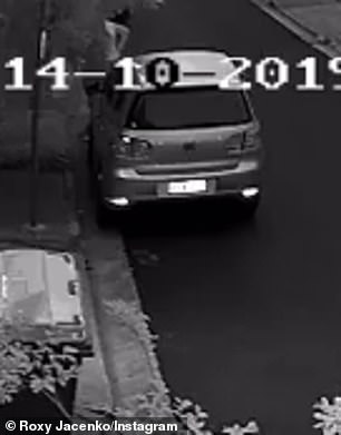 In another video taken on Monday morning, the jogger is seen once again crouching behind a car and relieving herself
