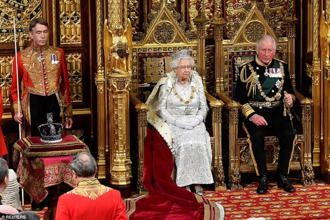 The Queen wearsthe George IV diadem as she sits next to the Imperial State Crown which is placed on a cushion today