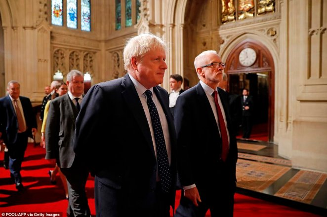Britain's Prime Minister Boris Johnson and Labour Party leader Jeremy Corbyn walk through the Peers Lobby this morning