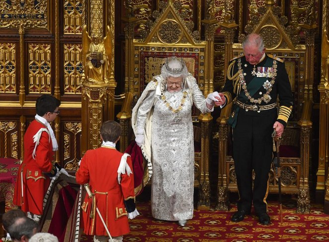 The monarch was assisted by Prince Charles as she carried out her constitutional duties at Parliament today