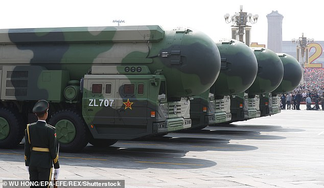 China's DF-41, or Dongfeng-41, is said to boast the longest range of any ballistic missiles in the world. The weapon is pictured being unveiled in a military parade in Beijing on October 1