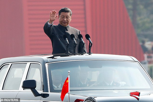 China's President Xi has warned that any attempts to divide the country would end in 'crushed bodies and shattered bones'. The leader is pictured at the National Day parade on October 1