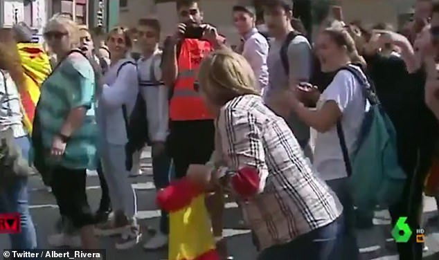 The anti-Catalan independence demonstrator waved a Spanish flag and chanted, 'you're on Spanish soil' to a crowd of separatists