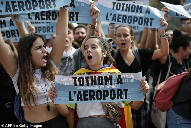 """Students protest holding banners reading """"All to the airport"""" in Barcelona today as demonstrations broke put across the region"""