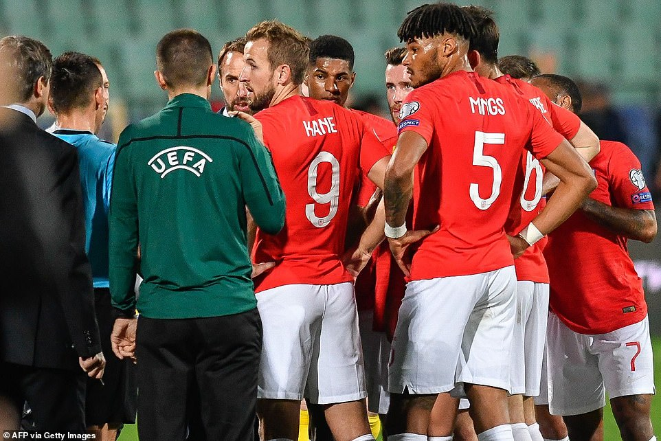 England's forward Harry Kane speaks with the referees during a temporary interruption in the first half of the qualifier