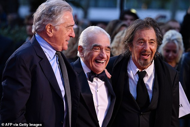 Al Pacino, filmmaker Martin Scorsese and Robert De Niro pose on the red carpet as they arrive at the premiere of the film The Irishman