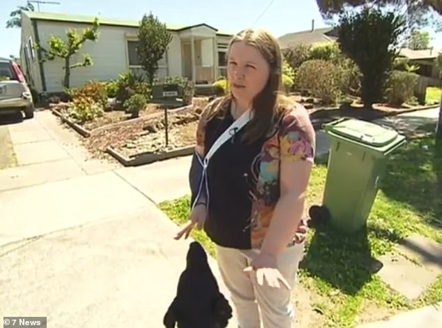Louise Gavin approached the dog after she noticed it on a street near her home in Melbourne's southeast and was worried it could be hit by a car