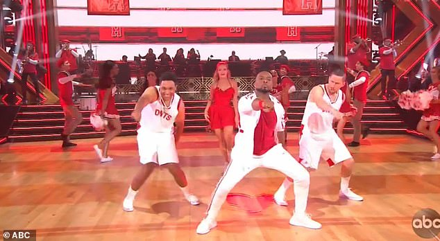 Up front: Kel Mitchell was up front and in the center during propulsive jazz routine with Witney Carson to We're All In This Together, from 2006's High School Musical