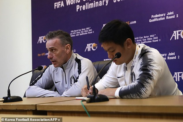 South Korean national football team head coach Paulo Bento (left) speaks to reporters ahead of the match in Pyongyang