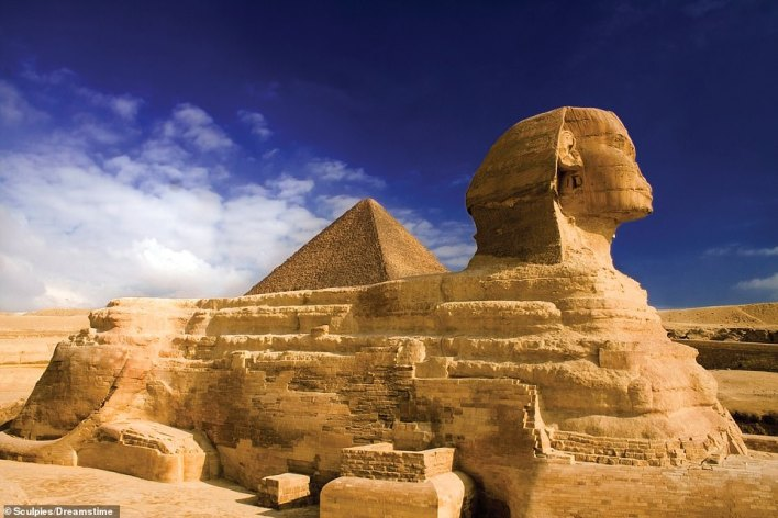 This iconic view of the two star attractions of the Giza plateau shows the Great Pyramid, created for the Pharaoh Khufu, standing behind the Great Sphinx of Giza. The Sphinx is believed to have been built for the Pharaoh Khafra, who constructed the second Giza Pyramid