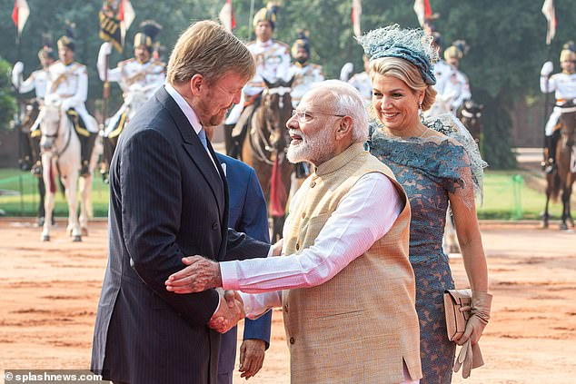 The king, who wore a black suit layered over a white shirt, shook the prime minister's hand and he arrived to the Indian capital yesterday