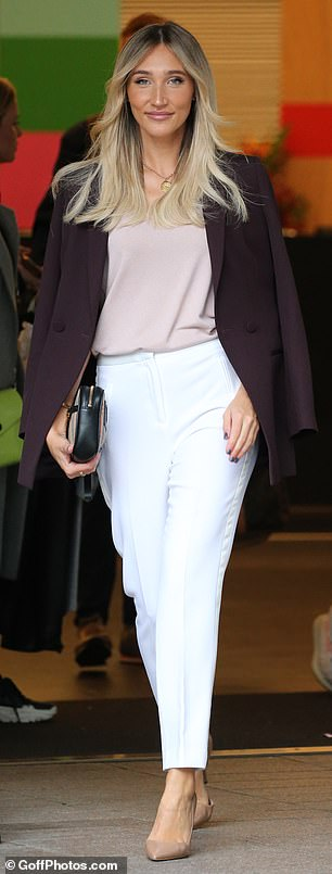 Smart: To tie her elegant ensemble together Megan wore a blush top which she tucked into her striking white trousers
