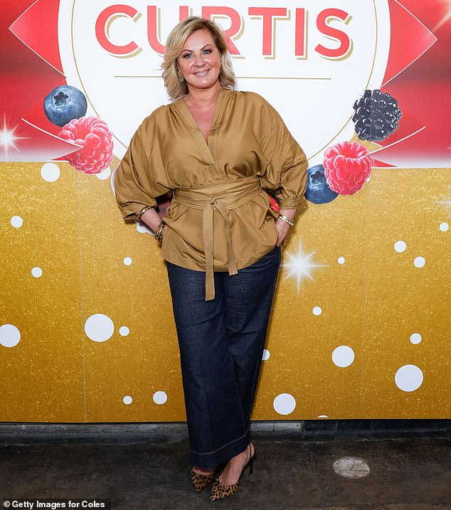 In the wild: Former Real Housewives of Melbourne star Chyka Keebaugh, 50, wore a tan kimono style top, teamed with indigo flares and leopard print heels