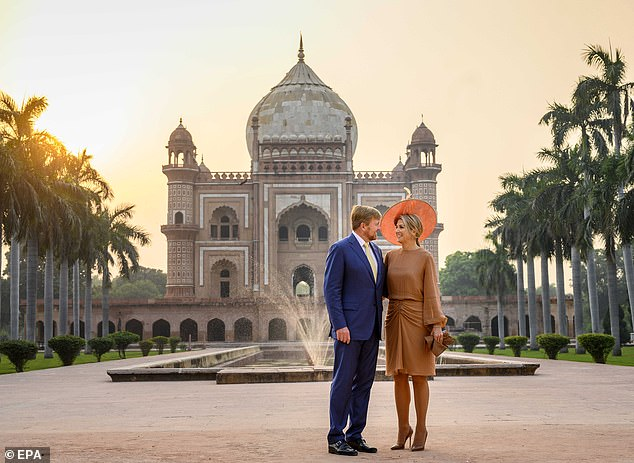 The couple appeared in high spirits as they stopped for a photo in front of the beautiful sandstone and marble mausoleum