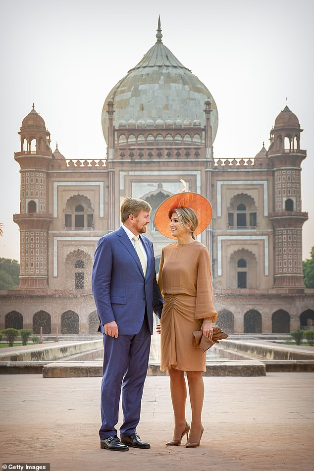 The king and queen gazed into each other's eyes as they stood in front of the Mughal architectural style tomb