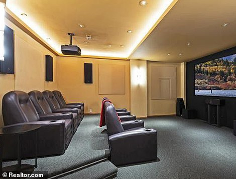 When off the basketball court, it appears the NBA player, also known as MJ, likes to kick back and relax in a cinema room complete with reclining seats and a huge screen