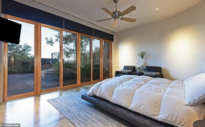 Elsewhere in the pad, winding staircases lead to the master suite and floor to ceiling windows offer breathtaking views of the surround scenery