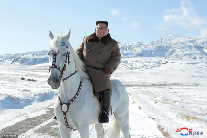 The North Korean leader looks in high spirits as he rides the animal, smiling for photos while taking a break from his gallop