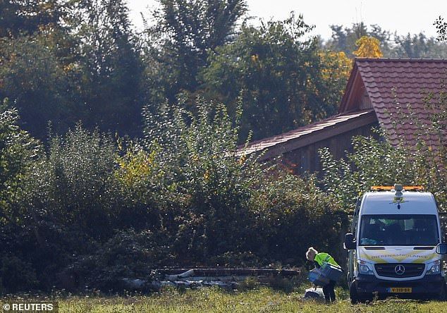 Police continued working at the property Wednesday, as they try to unravel the mystery of how the family came to be there, and whether they were being kept against their will