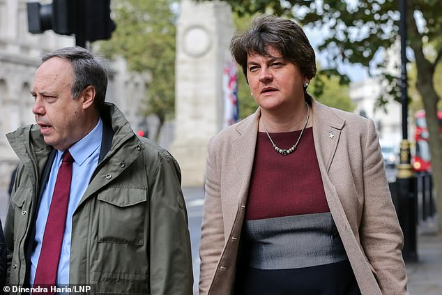 Number 10 has been locked in talks with the DUP in recent days over whether the unionist party can support a proposed deal. Arlene Foster and Nigel Dodds are pictured leaving the Cabinet Office today after a meeting with the PM