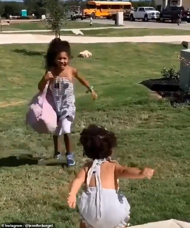 9-year-old Jayda (left) sprints across her neighbor's yard to meet her little sister after being dropped off by the school bus