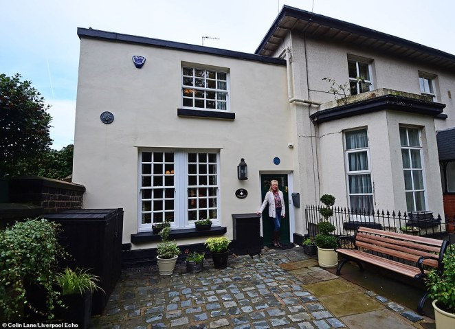 The childhood home of John Lennon in Woolton, Liverpool, which is ready to be rented out as an AirBnB. Pictured with American owner Kelley Kupfer