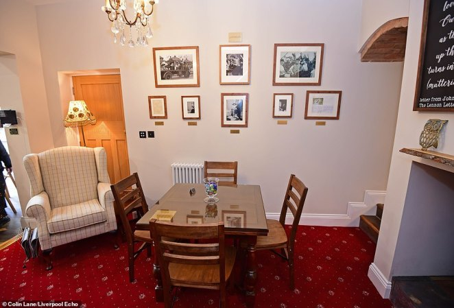 The furniture is set in the way the Beatle's family had it when they lived there, with frames and plaques to explain the artifacts placed around the home
