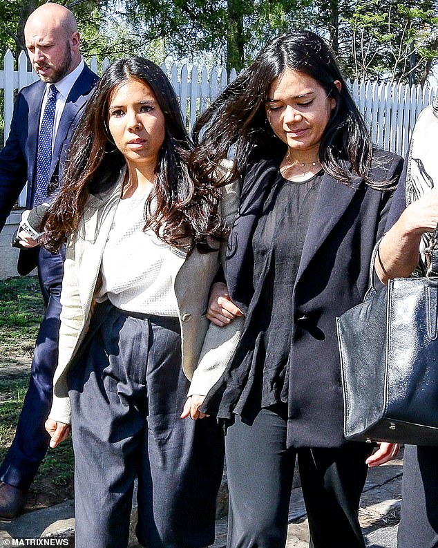 My sister's keeper: Nicola Teo walked arm-in-arm with her older sibling Alex as she faced charges which  prosecutors say could carry jail time