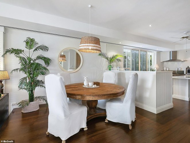The couple changed the colour scheme to a simple white and green, which they said helped toenhance the water views which can be seen from almost every single room in the house (pictured after)