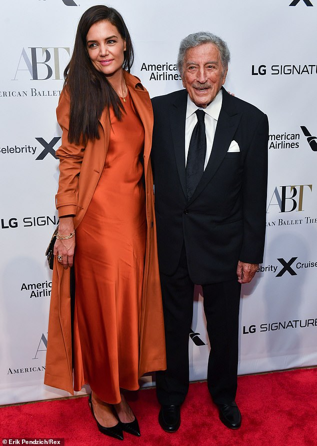 Side by side:While making her away around the red carpet, Katie got in a bit of posing with 93-year-old musical legend Tony Bennett