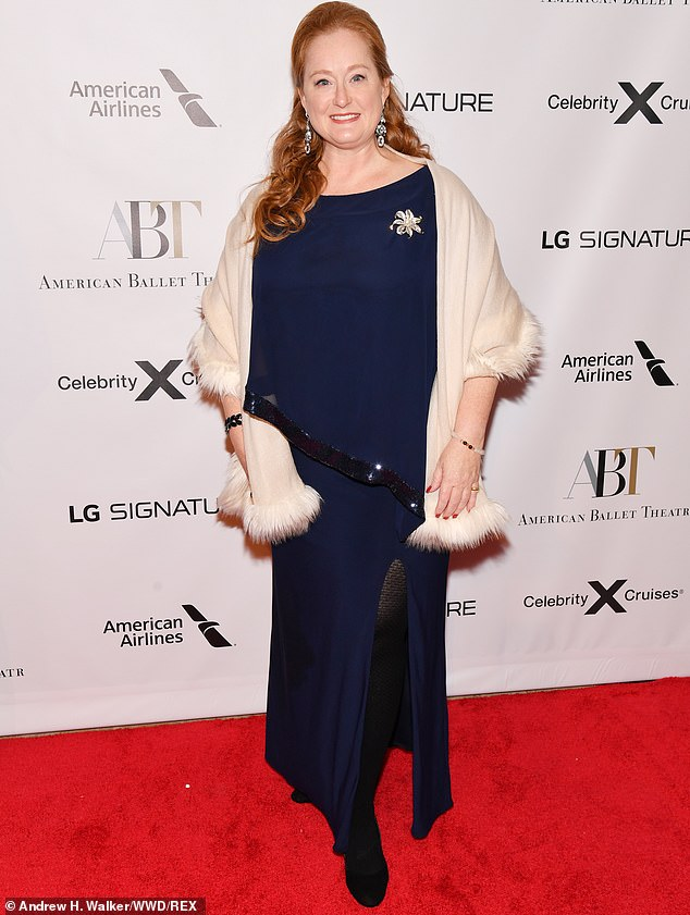 Tres elegant:Valerie Lettan pulled a cream fur-lined wrap over a split navy dress, adding a touch of dazzle with a glittering brooch
