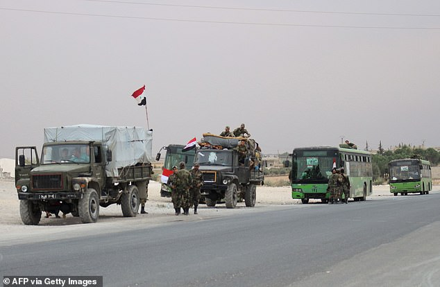 On the road to Kobane: Assad's forces heading towards the border town on Wednesday