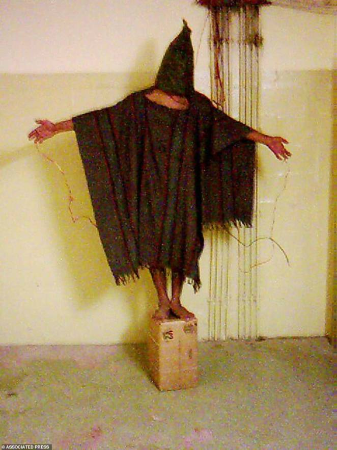 An unidentified detainee standing on a box with a bag on his head and wires attached to him in late 2003 at the Abu Ghraib prison in Baghdad, Iraq. Years after being released by the US military, former detainees held in Abu Ghraib and Guantanamo Bay Naval Base suffered debilitating injuries and mental disorders from their interrogation and alleged torture, according to a report by a human rights group in 2008. This image received 14 per cent of the vote