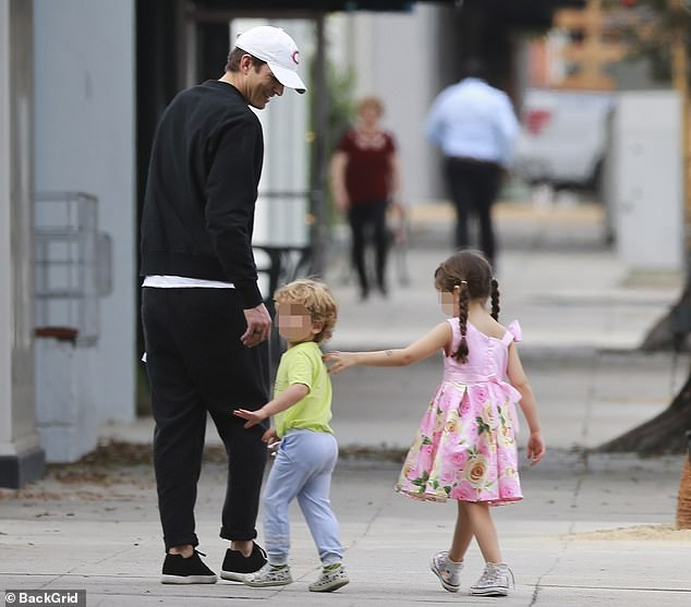 Devoted dad: Ashton Kutcher took daughter Wyatt, five, and son Dimitri, two, with him when he ran errands in Beverly Hills on Tuesday