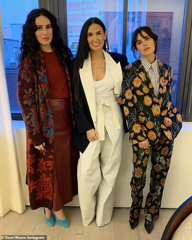 Doing better than ever: Moore, seen center with her stunning daughters Rumer (L) and Tallulah (R), is thriving these days thanks to her book and new movies