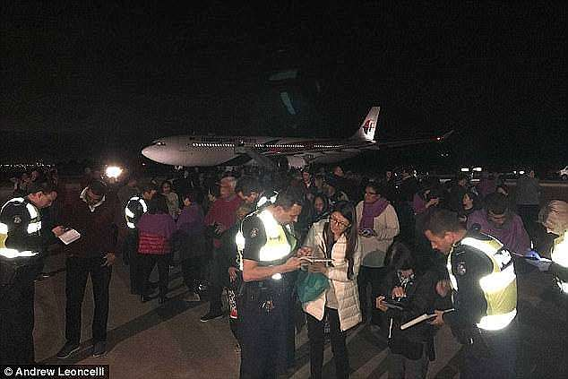 The plane landed within 15 minutes, but it took 40 minutes for security to arrive and passengers had to remain on board for nearly 90 minutes after