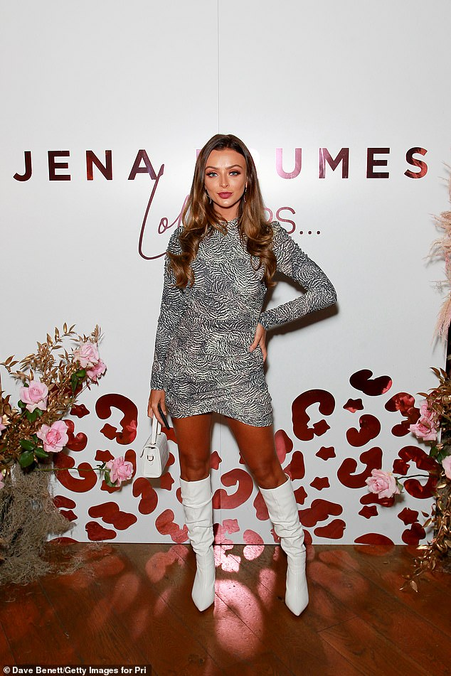 Glam: Kady looked glam in a black and white animal print mini dress, which she teamed with white knee-high boots