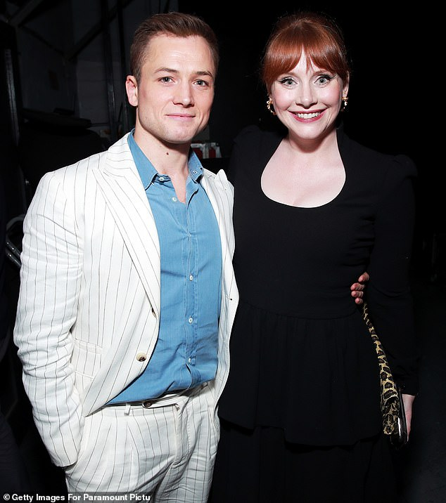 Back together: Rocketman stars Taron Egerton (L) and Bryce Dallas Howard were reunited on Thursday, as they attended a live concert screening of the film at Los Angeles' Greek Theatre