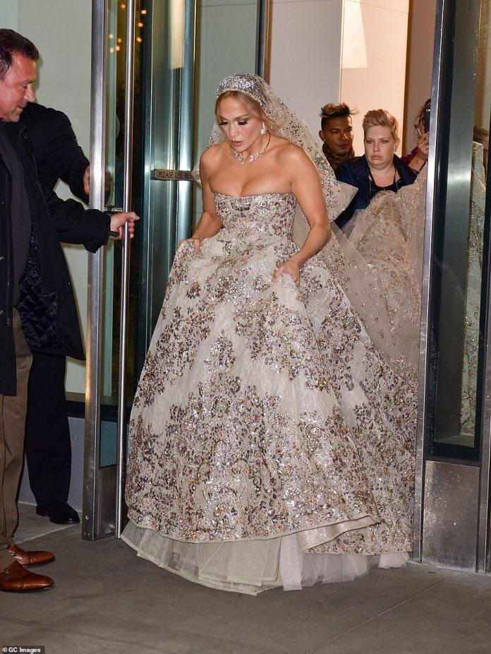 Glamorous: Jennifer looked noting short of sensational as she departed the Atelier Condo Building