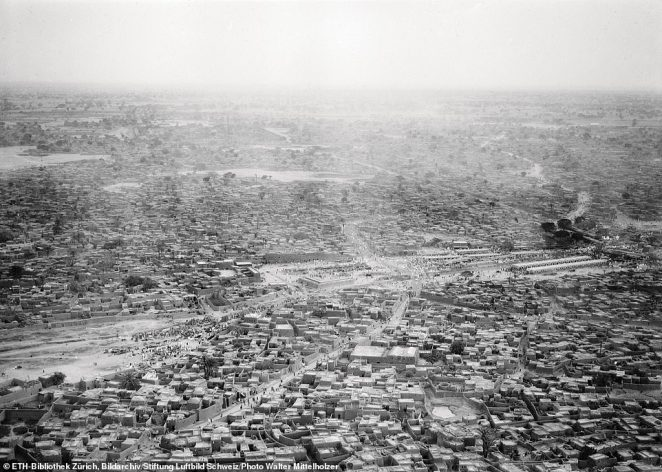 A photograph of Kano in Nigeria, taken by pioneering Swiss aviator Walter Mittelholzer in 1930. He made history in 1926 by becoming the first person to fly from the south to the north of Africa. And he banked another world first in 1929 when he flew over Mount Kilimanjaro