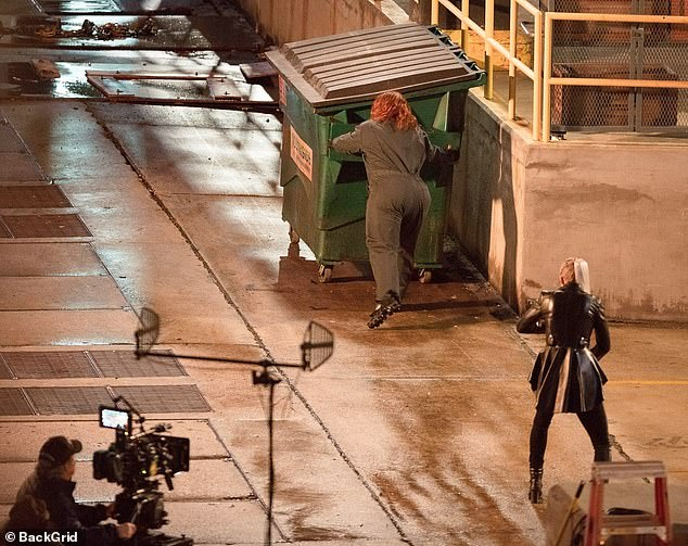 Hot pursuit: The cameras rolled as the 49-year-old Oscar nominee - dressed as a janitor - appeared to push a dumpster as the platinum-blonde 33-year-old followed her