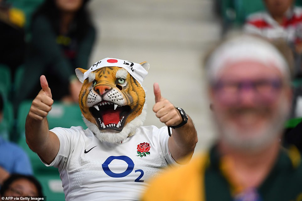An England fan watches from the stands in Oita stadium for today's quarter-final clash against bitter rivals Australia