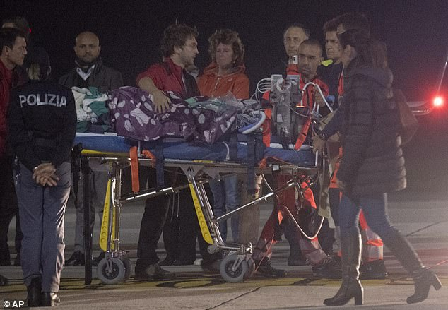 The Learjet air ambulance - which almost didn't leave due to bad weather in Genoa -landed in Biggin Hill airfield, Kent, on Tuesday to transfer Tafida. Pictured: Tafida on a stretcher arrives atGenoa's Cristoforo Colombo Airport