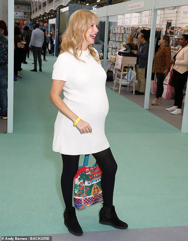 Bumping along: The Countdown star was full of smiles as she posed for pictures at the show with her growing bump on full display