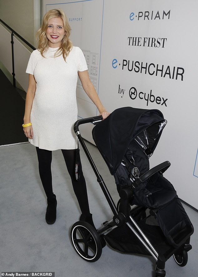 Glowing: Rachel Riley, 33,looked radiant as she showed off her growing bump in a white knitted dress at the Baby Show in London on Saturday