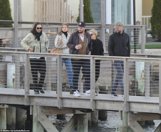 Maroney (far right) is seen boarding the ferry to Rose Island with other guests for the rehearsal dinner